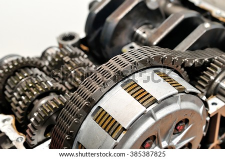 Motorcycle clutch with drive chain and gears.