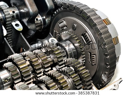 Motorcycle clutch with drive chain and gears in front. - stock photo