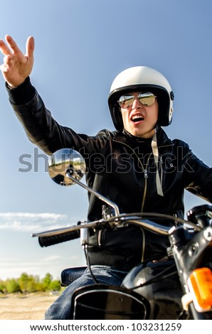 Motorcycle cop in a helmet and goggles - stock photo