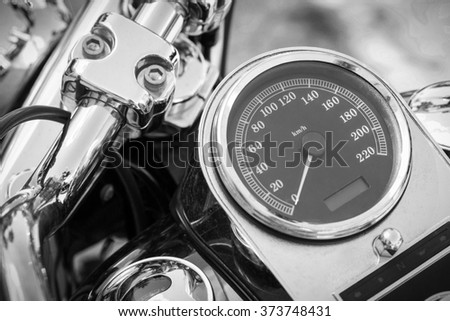 Motorcycle detail with mirror, speedometer and handlebar. Details closeup.  Black and white