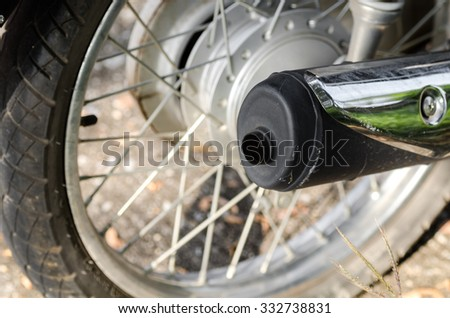 motorcycle exhaust,Chromed exhaust on a motorcycle - stock photo