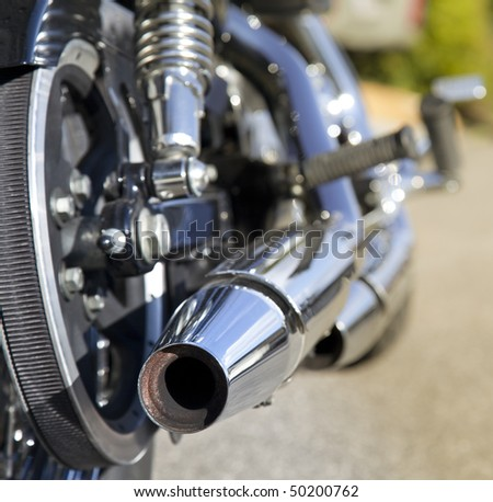 motorcycle exhaust closeup - stock photo
