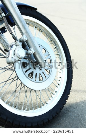 Motorcycle forks and tire, close-up - stock photo