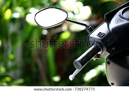 motorcycle mirror on grass background
