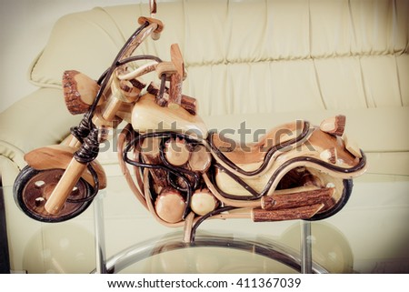 Motorcycle models made of wood used for decoration or display. - stock photo