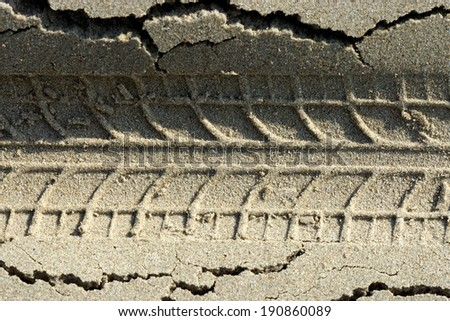 Motorcycle motocross tracks in the sand. - stock photo