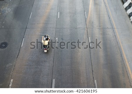 motorcycle moving and blurry on road ,shots with top view,selective focus at road - stock photo