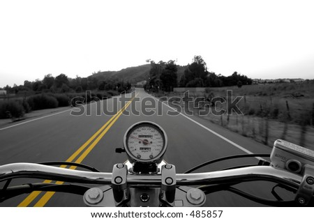 Motorcycle moving on a straight road from rider's perspective - stock photo
