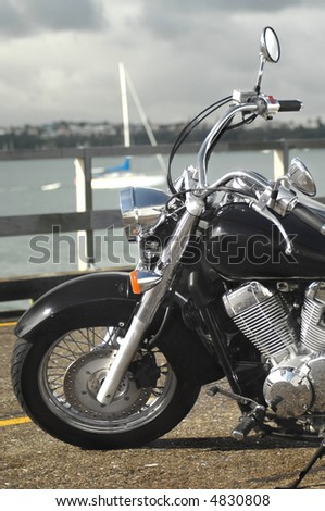 Motorcycle near water - stock photo