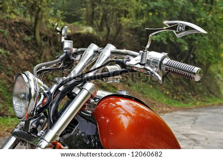 motorcycle on a road in the forest - stock photo