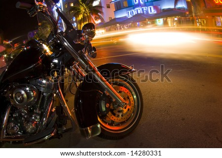 motorcycle on ocean drive night scene south beach miami florida - stock photo