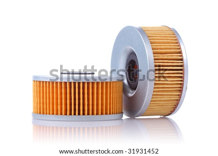 motorcycle parts: oil filters, isolated on white - stock photo