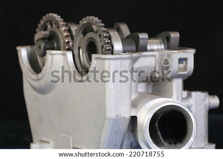 Motorcycle racing engine with head removed to reveal damaged camshaft gears. - stock photo