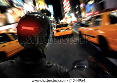 Motorcycle Rider in Busy City Traffic - stock photo