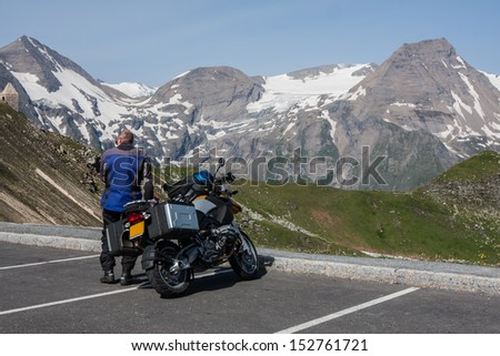 motorcycle rider watch the view of Grossglockner austria - stock photo