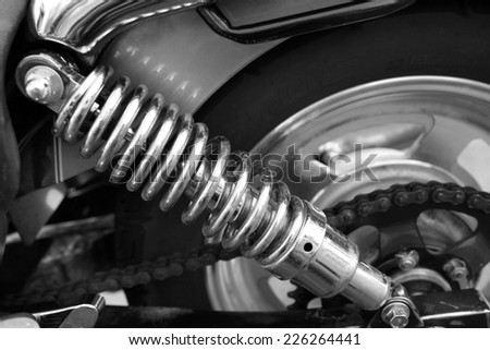 Motorcycle shock absorber, close-up - stock photo