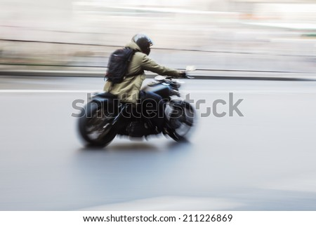 motorcycle speed in motion blur - stock photo