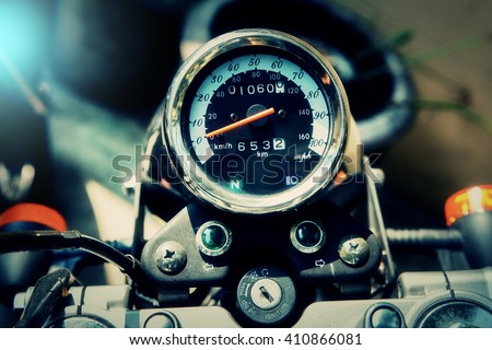 motorcycle speedometer with chrome ring in vintage color - stock photo