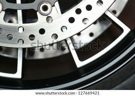Motorcycle wheel in black and white with ABS brakes. - stock photo