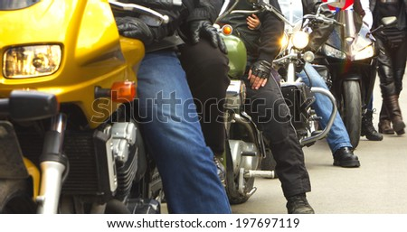 Motorcycles and riders - stock photo