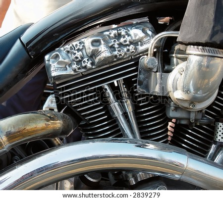 Motorcycles engine with skulls - stock photo