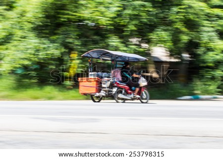 Motorcycling Panning In Thailand - stock photo