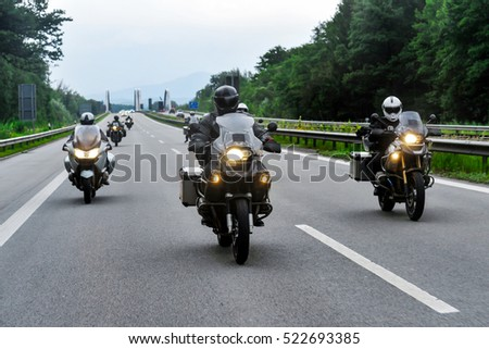 Motorcyclist convoy pass through the highway