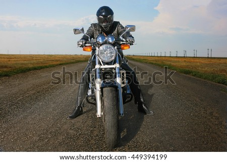 motorcyclist on the motorcycle in helmet on the road - stock photo