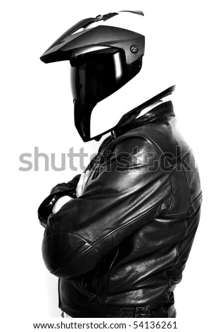 Motorcyclist with helmet and leather jacket - stock photo