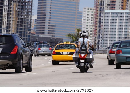 Motorcyclists on the highway - stock photo