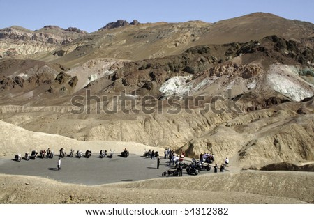 Motorcyclists taking a break in Death Valley. - stock photo
