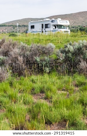 Motorhome parket at scienic view near I70. - stock photo