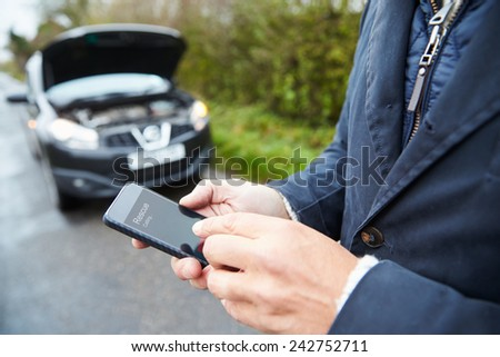 Motorist Broken Down On Country Road Phoning For Help - stock photo