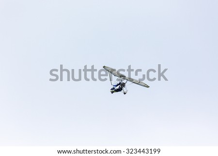 Motorized glider in the sky - stock photo