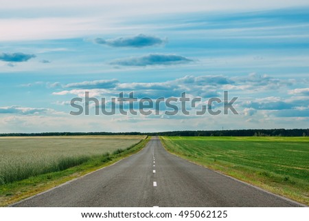 Motorway asphalt with an empty in the green fields of the countryside. Nobody