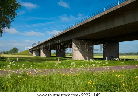 motorway at Deventer Netherlands. This is the main west-east connection in the Netherlands. It leads from Amsterdam to Berlin in Germany. - stock photo