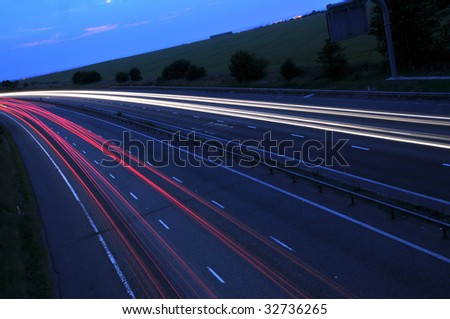 Motorway at night - stock photo