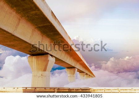 Motorway, Expressway, Freeway the infrastructure for transportation in modern city, urban view against the cloudy sky background.  - stock photo
