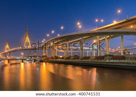 Motorway, Expressway, Freeway the infrastructure for transportation in modern city, urban view at twilight time. - stock photo