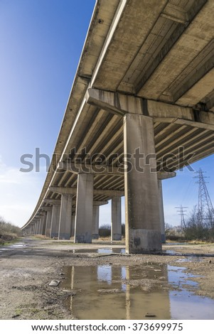 Motorway flyover viewed from below against a blue sky - stock photo