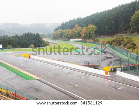 motosports, extreme, weather and race concept - close up of speedway track or road and snow - stock photo