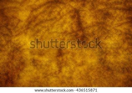 Mottled yellow wall in easter yellow. - stock photo