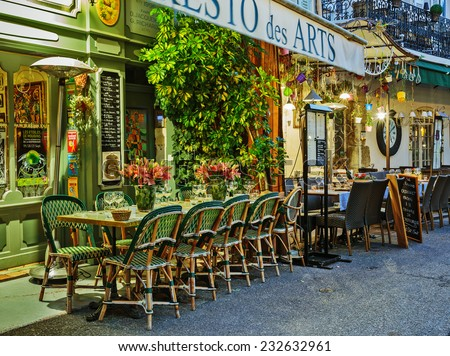 MOUGINS, FRANCE - OCTOBER 31, 2014: Street cafe at night - stock photo
