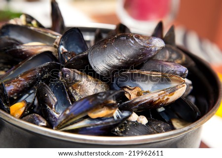 moule mariniere served in a pot. - stock photo