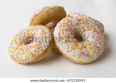 Mound of donuts. Crumpet for tea. Tasty food cakes. Delicious classic cakes: fried doughnuts glazed with caramel. Nutritious dish that promotes obesity. - stock photo