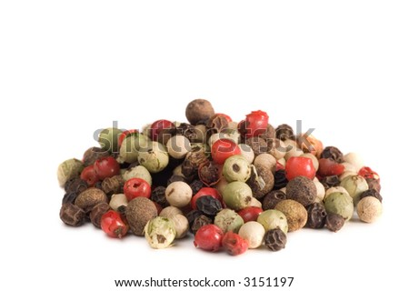 Mound of peppercorns isolated on white - stock photo