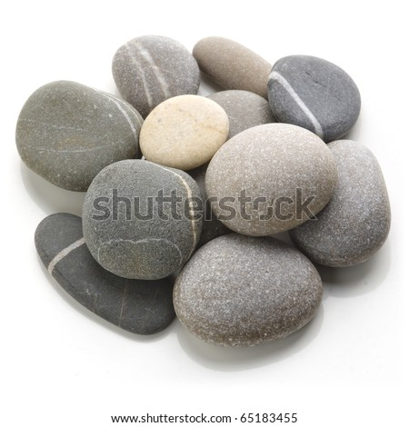 Mound of stones on a white background. Oblique view from the top. - stock photo