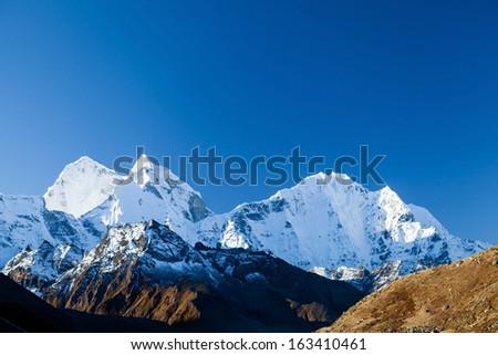 Mount Ama Dablam in Himalaya Mountains, Nepal. Beautiful Himalayan landscape on sunny autumn day. - stock photo