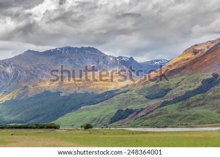 Mount Aspiring National Park, Matukituki River and beautiful hills - stock photo