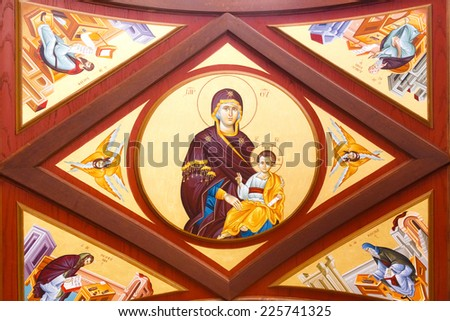 MOUNT ATHOS - MAY 21, 2014: The icon of Virgin Mary an Christ painted onto church ceiling in Holy Mount Athos.  Mount Athos is a World Heritage Site and autonomous polity in the Hellenic Republic - stock photo